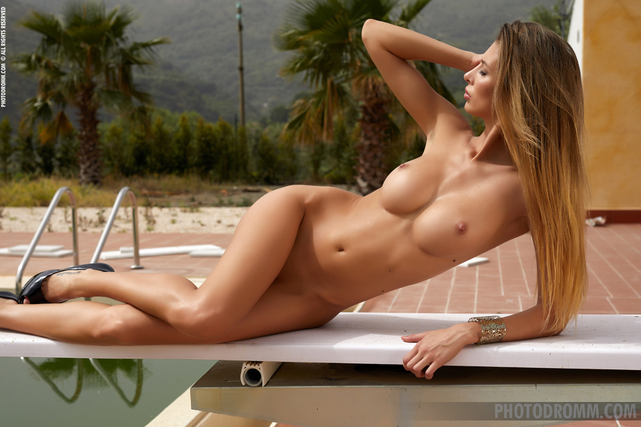 Claudia Stripping by the pool